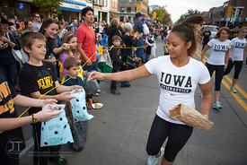 A member of the UI Gymnastics team hands out candy in the  University of Iowa homecoming Parade on Clinton St in Iowa City on Friday September 28, 2012. (Justin Torner/Freelance)
