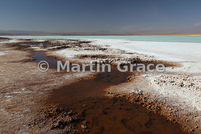 Laguna Tebinquiche, Salar de Atacama, showing the salt encrustation round the margin due to evaporation of the saline-rich water, Region ll Antofagasta, Chile