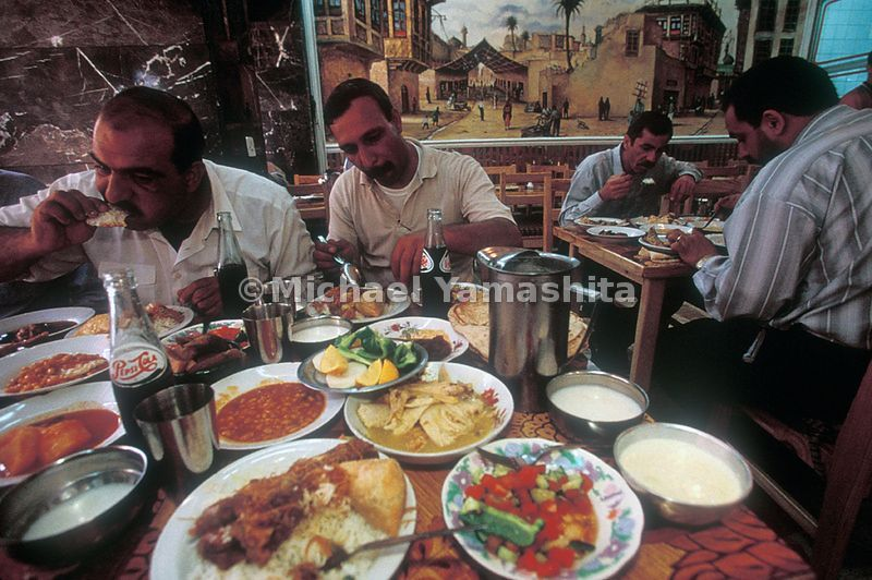 Men sit down to eat at a restaurant in Iraq.