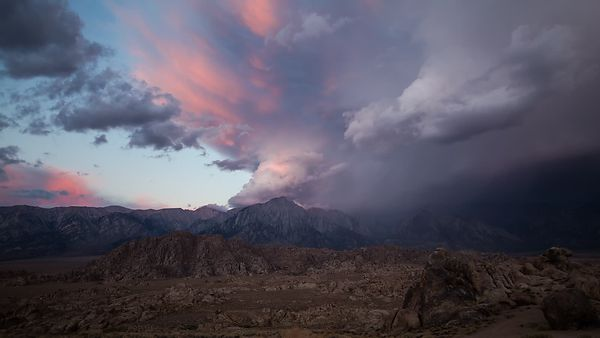 Wide Shot: Soft Pink Sunrise Over the Eastern Sierras Following a Billowing Thunderstorm (Moving Camera Shot)