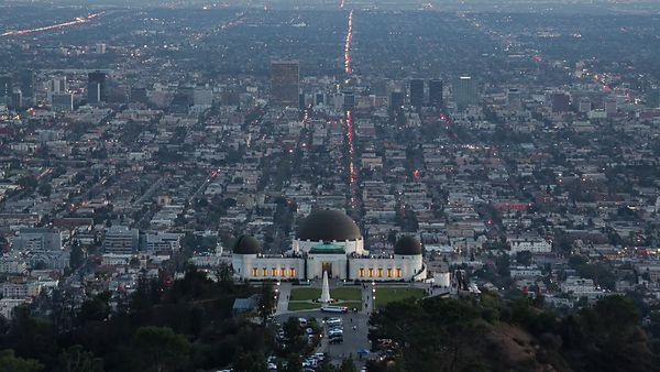 Bird's Eye: Griffith Park Observatory Saddles A Sprawling Metropolis (Day to Night)
