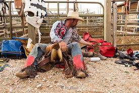 A cowboy getting ready for rodeo at Bryce Canyon Country Rodeo in Utah.