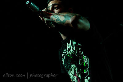 Adrian Estrella, vocals, Assuming We Survive