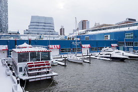 A paddle wheeler at Chelsea Piers in New York on snowy day.