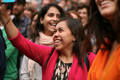 Ecstatic Woman in Crowd