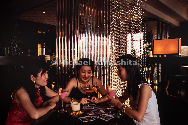 Young friends celebrate a girls night out at an exclusive restaurant and bar in Shanghai, China.
