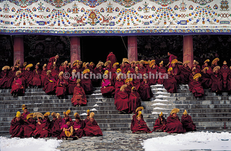 Monks of all ages wait for morning prayers and the only meal of the day.