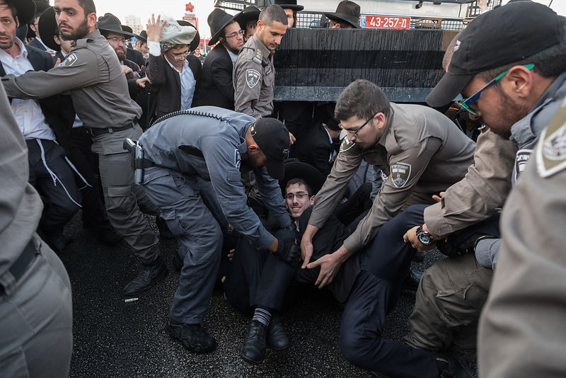 Ultra-Orthodox Jewish men protes