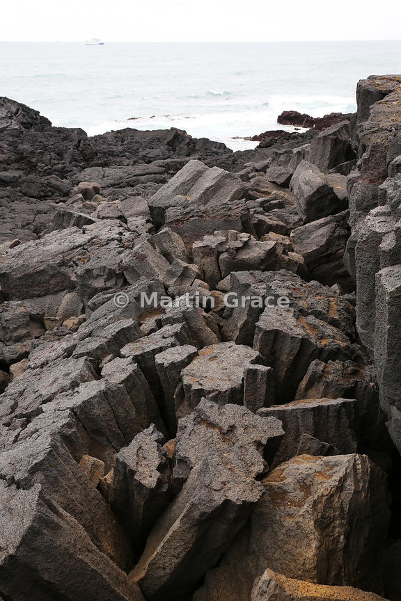 Basalt columns eroding away from cliff face at Reykjanesta, Reykjanes Peninsula, Iceland