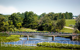 Riders crossing a bridge at KW Classic, Hawkesville, On, June 7, 2015