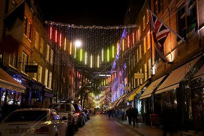 Christmas Lights in Monmouth Street leading to the Cambridge Theatre