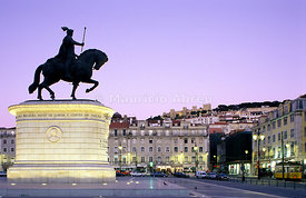 The historical centre at Praça da Figueira and the São Jorge castle, with King Dom João I equestrian statue. Lisbon, Portugal