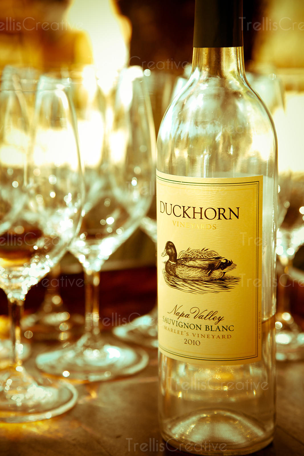 A bottle of sauvignon blanc wine and fine crystal glasses at Duckhorn Winery