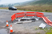 Asbestos material dumped illegally in a roadside laybye, Cumbria, UK.