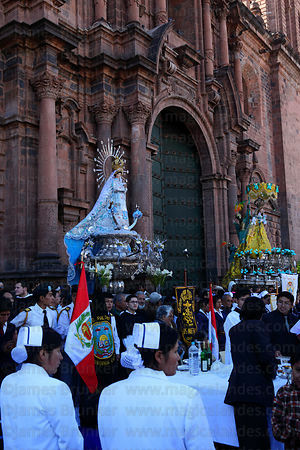 Figures of Virgen of the Immaculate Conception (left) and Belen outside cathedral , Corpus Christi festival , Plaza de Armas , Cusco , Peru