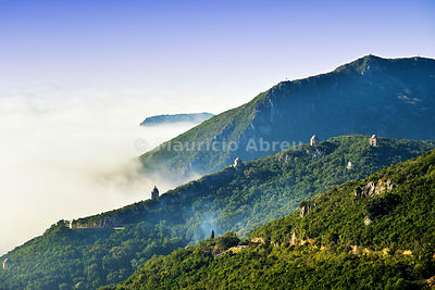 Arrábida Nature Park in a foggy morning with the chapels of the convent spread on the mountains. Portugal