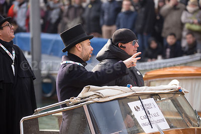 Venice Carnival Officials in boats at the Rio di Cannaregio water parade