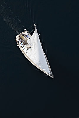 Sailboat in calm bay from above