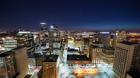 Medium Shot: Downtown Kansas City Streets Bathed in Night Light & Traffic After Dusk