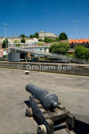 canon on lock side cumberland basin with clifton in the background bristol england