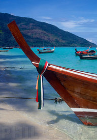 tropical beach with boats and white sandy beach