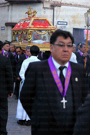Devotee in front of Santo Sepulcro / Crucified Christ during Good Friday procession , Cusco , Peru