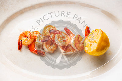 Prawns Shrimps roasted and served with lemon
