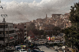 AA swarm of locusts flies over the center of Mdagascar capitol Antananarivo on August 28, 2014.