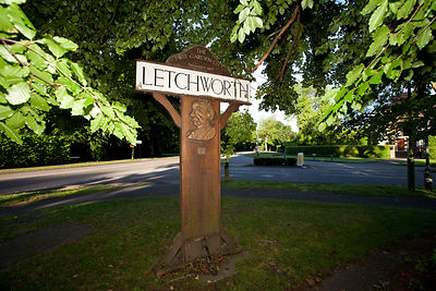 UK - Letchworth Garden City - A road sign bearing the image of the founder of Letchworth Garden City, Ebenezer Howard