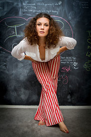 Sara Glasser Havens, an author and life coach, poses in front of her chalkboard in Los Angeles
