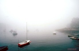 Red boat in fog