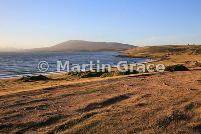 Evening sunlight over Pebble Island, West Falkland, looking from the Settlement to First Mountain