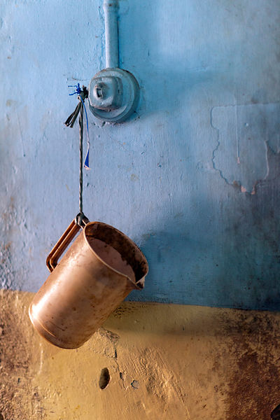 India - Kottayam - A detail of a jug tied to a wall in the Indian Coffee House, Kottayam