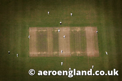 aerial photograph of  village cricket match in  Gloucestershire  England UK