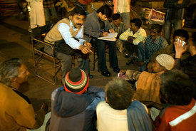 India - Delhi - A psychiatrist and a social worker lead a group therapy session in Urdu Park for the homeless and addicted poor.