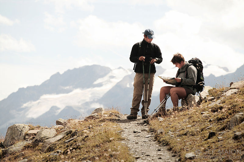 Backpackers looking at map in mountain