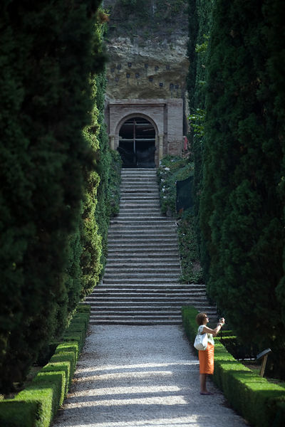 Italy - Verona - A tourist takes a photograph in the Giardini Giusti