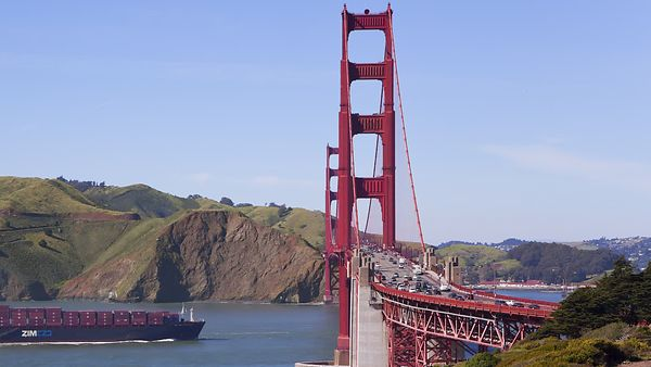 Close Up: A Giant Barge Floats Under The Fast Traffic On The Golden Gate Bridge