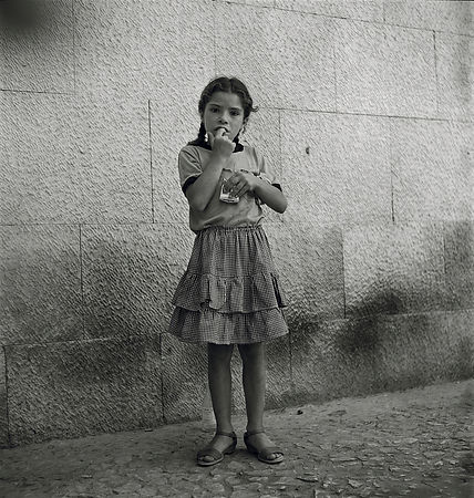 GIRL WITH CIGARETTE BOX, LISBON  1983