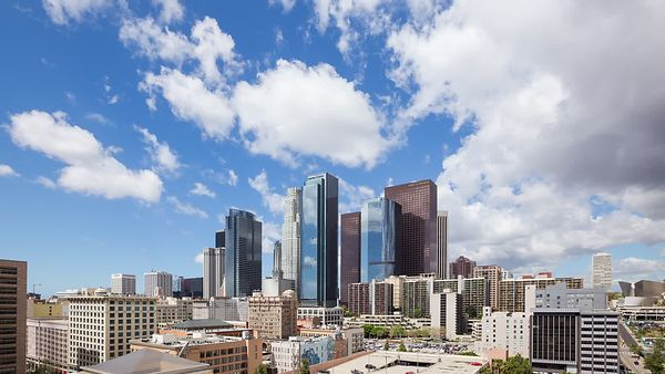Wide Shot: Moving Shadows Of Cumulus Over Reflective Glass, Steel & Concrete, Downtown L.A.