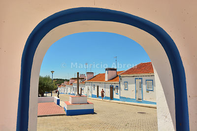 The traditional little village of Santa Susana, very rich in traditional architecture with white washed houses and a strong blue surrounding windows and doors. Alentejo, Portugal