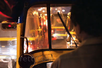 Auto rickshaws at night near the Dharavi slum and Mahim, Mumbai, India.