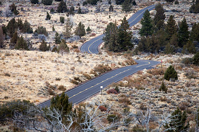 Road through beautiful desert grasslands in Lava Beds National Monument and Tule Lake NWR, California