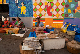 A women vendor at Sassoon dock, one of the largest fish markets in Mumbai, India