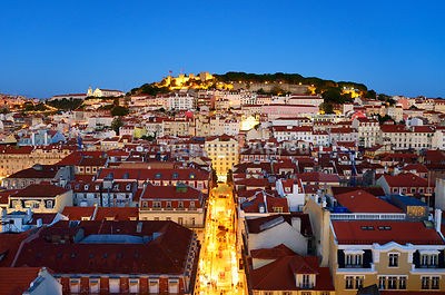 The historic centre (Baixa) and São Jorge castle at twilight. Lisbon, Portugal