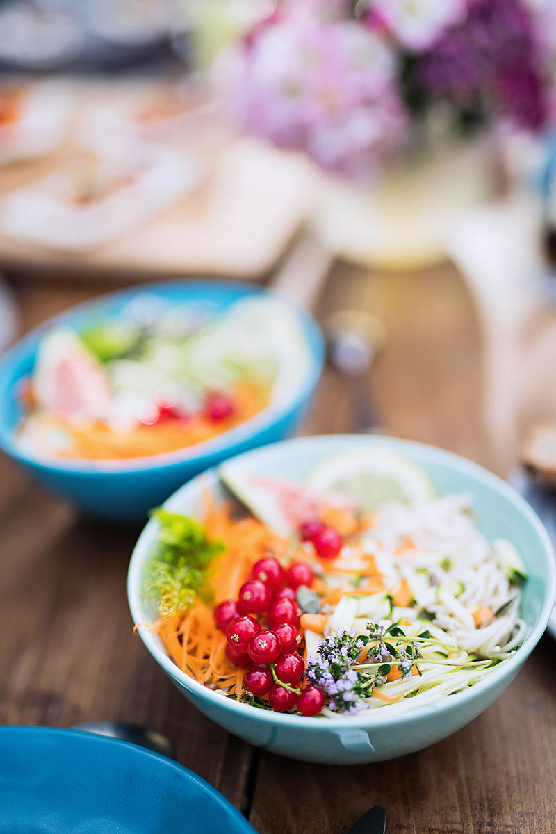 Close-up on a colorful salad in a bowl on a wooden table