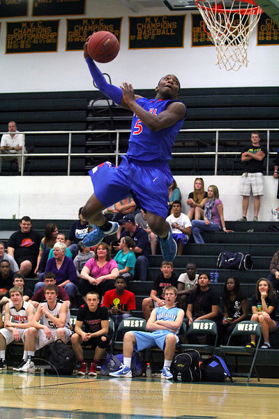 Davenport Central's Demetrius Butler participates in the slam dunk competition. The Northern All-Star team defeated the Southern All-Star team 73-70 Wednesday night in Iowa CIty. (Justin Torner/Freelance)