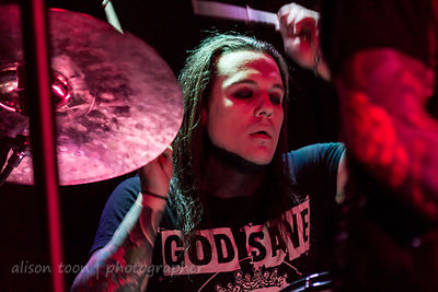 Trixx, on drums with Escape The Fate