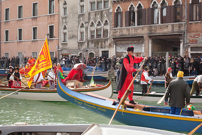 Colourful small boats in the Venice Carnival Water Parade on the Rio di Cannaregio Canal