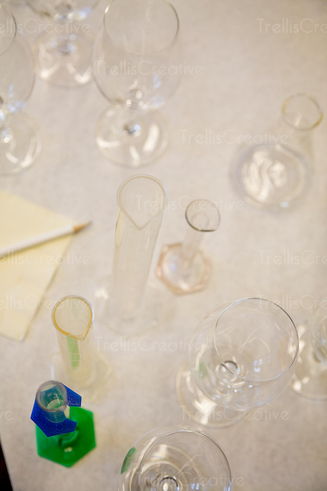 Looking down on empty glass beakers and wine glasses for testing chemical components in wine